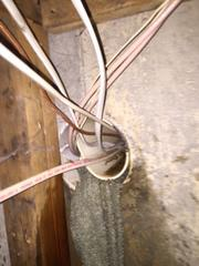 Here you can see the water coming out of the pipe in addition to the dampness and water stains on the wall.