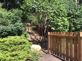 This image shows where the traditional fence ends and the subtle deer fence installation begins.