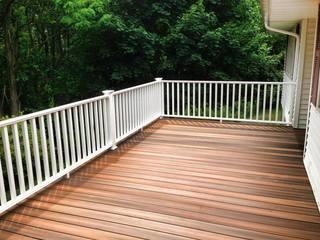"""After new CertainTeed Evernew deck in Newark. Fully composite """"Ipe Tropics"""" decking & white railings."""