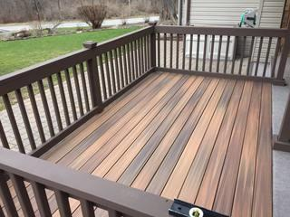 Composite decking with pressure treated wood railing system. Marion, NY