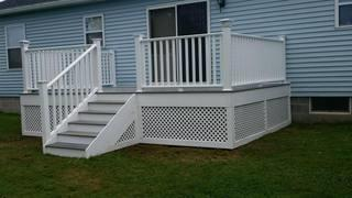 New gray fully composite deck with white trim and CertainTeed railing system.