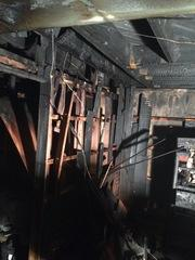 Heavy fire damage sustained in the basement.