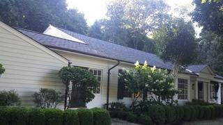 The front view of the home after the new roof was installed.