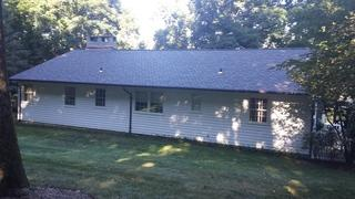 Rear view of the house after the new roof replacement.