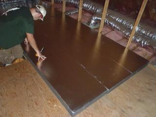 The Dr. Energy Saver Delmarva team is prepping to install the David Lewis Hatch Cover using SilverGlo Insulation.