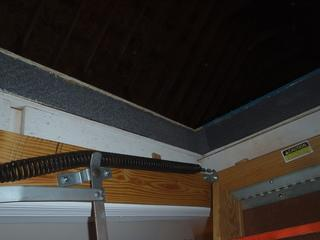 This photo captures another angle of the SilverGlo being installed along the sides of the attic pull down stairs.