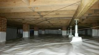 The end product: SmartJacks were installed to stabilize the floor above, while the encapsulation prevents any further mold or wood damage.