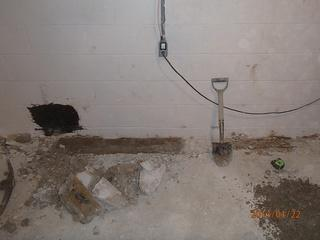 Much of the trench is dug by hand, using small shovels and hand held equipment. Once the footer, or main support of the home is exposed we can clean the area and begin installing the drainage pipe. Since our pipe rests on top of the concrete instead of next to it in the dirt, there is far less chance of it clogging up.