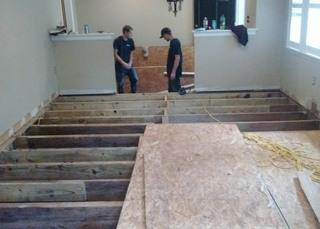 After removal of all rotten wood, Production Crew Foreman Matt Garcia and production crew members Jordan and Jason replaced all wooden beams and joists.  Ultimately, the subfloor of one large room and two hallways were solidly rebuilt.