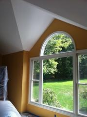 Changed wood trim to white and painted walls a nice yellow.