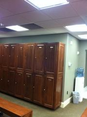 Painted walls green and stained wood lockers