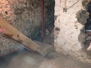 Here you can see the stone foundation as well as the old staircase leading to nowhere.