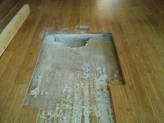 Cutting away the wood floors, PolyLEVEL technician and foreman TJ Harden noticed almost an inch space between the concrete foundation and the wood floor.
