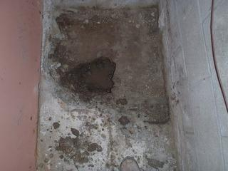 You can see the water filling up the small holes in the concrete. This is one of the reasons that we install a sump pump first. It will help to keep the work area clear of water. In this case, it kept the water out of the french drain that our crew was digging.