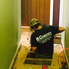 Renovation begins with Production Crew Member David H. removing the carpet and cutting out the floors.