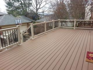 "We removed the wooden decking boards and installed Tamko EverGrain Composite Decking Boards and WeatherWise's Veranda Series vinyl railing with 3/4"" aluminum balusters."