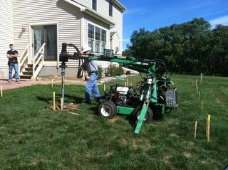 Our guys installing EZ Posts for a new deck