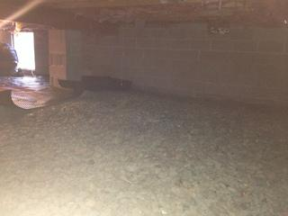 Here is a photo of the crawl space before we got to work. Although this crawl space does not appear to be as wet and dirty as most other crawl space we encounter, there were hidden problems that were contributing to the homeowners' discomfort. The floor were always cold, and there was a musty odor seeping up from the crawl space.
