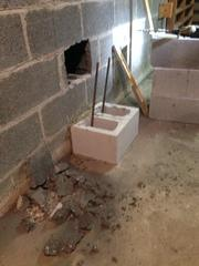 In order to get started we had to punch a hole into the existing wall break out a hole into the floor. This is the first step to adding structural integrity back into this home.