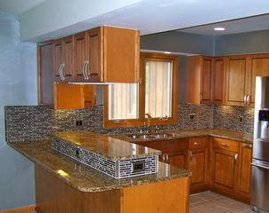 Another newly renovated kitchen done by Ecostar Restoration & Renovations. Look at that gorgeous tiling!