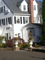 We painted the exterior of this Inn a striking white with black shutters.
