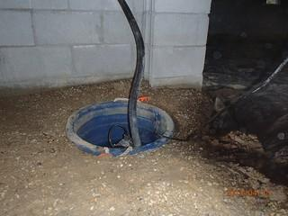 This sump pump in the crawlspace was not sealed and had a flimsy discharge pipe. These are often overlooked and can contribute to moisture issues in the crawlspace. Sealing the top will keep the water inside the container, rather than letting it evaporate into the air. Using a heavy and sturdy discharge pipe prevents leaks and lasts a lot longer.