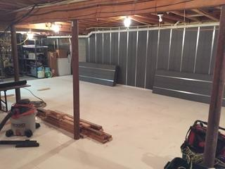 This image shows you the Basement to Beautiful panels and the ThermalDry decking systems tied together to create a completely different basement atmosphere.