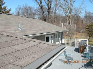 As the owners of this Elk River house spend time with friends and family on their deck, they don't have to be concerned about their clean, protected gutters.  All that's left is to enjoy their home.