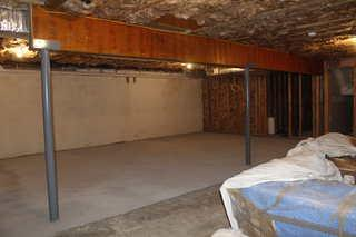 Before this basement was finished there was a lot of storage space, but no real living space for the family. The basement was dark and uninviting and needed a major face lift.