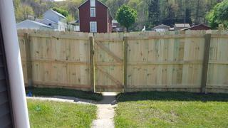 This is a photo of the completed 6' privacy treated wood fence and gate.