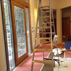The windows were already installed and the painting is in progress.