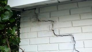 This is the crack in the outside of the home before we installed the Push Pier System. This is an example of a stair-step wall crack and is a side effect of a shifting foundation.