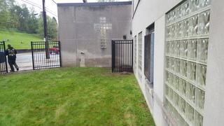 This is a side view photo of the completed aluminum fence install by Pro Fence & Railing.