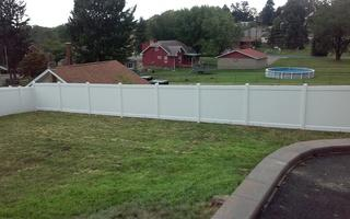 This is a full photo of the white pvc fence we installed.