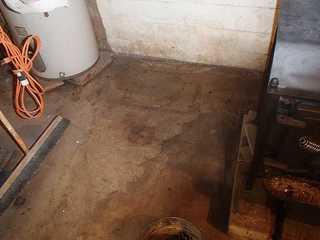 You can see in this photo the dampness on the basement floor. In result, mold will start to grow.
