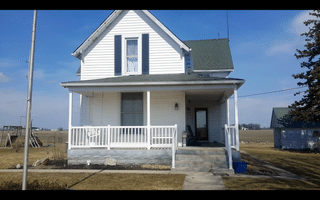 The old vinyl siding was damaged by wind. Roof It Forward received a full siding replacement from the insurance company on this beautiful home.