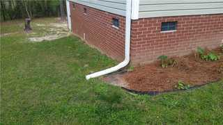 This side of the Columbia home had the most problems and difficulties.  System Design Specialist Eddie Mathis had the solution for a french drain and push piers to stabilize this side of the home.