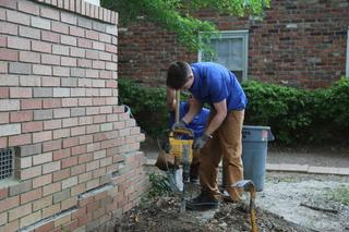 The first step of this push pier system is to dig 4 ft holes to reach the foundation footers of the home.