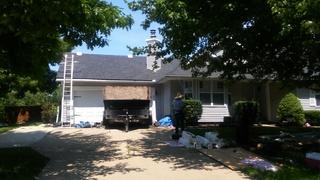 Our contractors were working hard to completely replace the shingled roof of the home to get it ready for market.