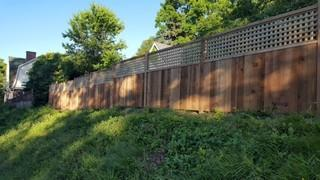 This photo shows just how great a cedar fence with a lattice top looks.