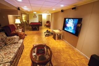 The homeowners in this home took full advantage of the living space they purchased when they bought the home. The basement was not only turned into a family room, but also a beautiful game room.