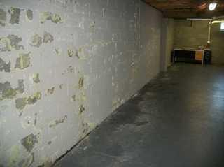 "This is a really common sight in local Delmarva basements. A lot of people paint the basement walls with a thick ""waterproofing"" paint. The idea is to lock out the moisture and keep the basement dry. The only problem it that the water vapor builds up behind the layer of paint and then pops through. Not only does this look awful, but imagine the cost and effort of painting it over and over again."