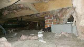 Upon inspection by Specialist Ward Purvis, he discovered that the crawl space was filled with debris.