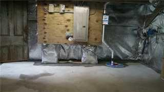 DryZone installed a SuperSump to keep the water out of the basement and into the pump.