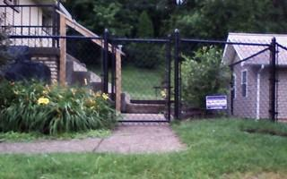 The finished chain link fence.