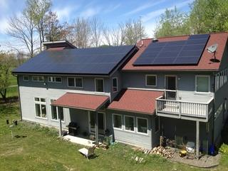 Here is picture of a 52-panel, 12.22kW solar panel installation in Ithaca, NY.  This is the 3rd project this energy-conscious customer has hired Halco to complete over the last few years, as we have also installed a Navian Combi on-demand hot water heater and a geothermal heating system for his home.  With the addition of this solar PV system, this customer has achieved net zero sustainability--which means it uses the same amount of energy that it produces.  This negates the need for a 3rd party utility provider and better yet, no more utility bills!
