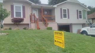 The front of this home has a new look with brand new siding.