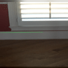 After stabilization and lift #1: the laser level line is even along the baseboard