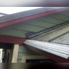 Our gutter installation works in conjunction with this Bremerton home's metal roof to prevent water damage.