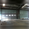Since this metal garage is used to store diesel equipment, the right kind of insulation was necessary to keep the equipment warm during the colder months. Coastal Insulation, Inc was up to the task!
